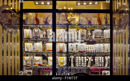 VILNIUS, LITHUANIA - DECEMBER 26, 2014: Night show-window of shop of the Lithuanian amber and jewelry. Explored - Stock Photo