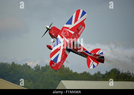 Rich Goodwin displays some extreme aerobatics at the Dunsfold Wings and Wheels Show with his Pitts Special - Stock Photo