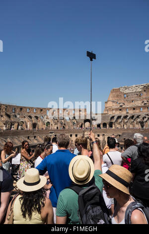 Rome. Italy. Crowds of tourists inside the Roman Colosseum. - Stock Photo