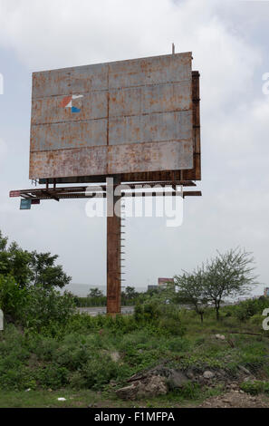A blank hoarding on the roadside between Mumbai and Pune in India - Stock Photo