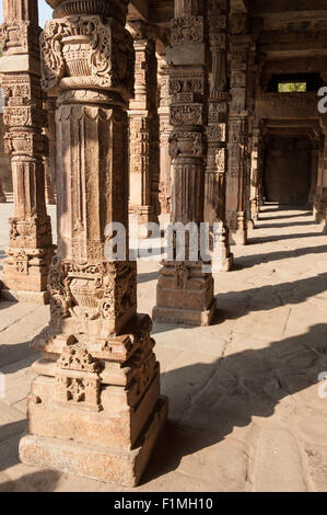 Delhi, India. Quwwat-ul-Islam Mosque in the  Qutub Minar complex. Carved columns. - Stock Photo