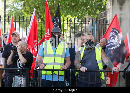 Far-right, anti-Semitic and racist groups hold a rally whilst anti-fascists hold a counter-protest nearby in London's - Stock Photo