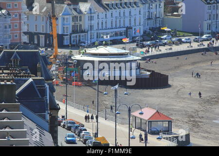A view of Aberystwyth's new bandstand under construction along with the recently repaired public shelter on a hot - Stock Photo