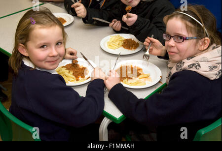 Primary school pupil's having their lunch, London, UK. - Stock Photo