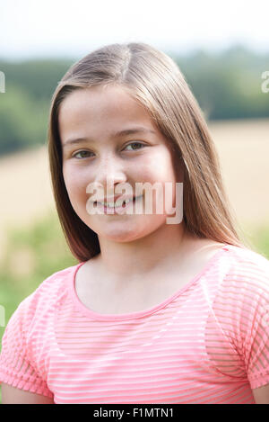 Outdoor Head And Shoulders Portrait Of Girl - Stock Photo