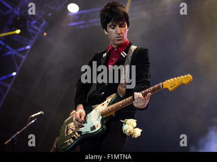 Johnny Marr playing guitar at Victorious Festival 2015. - Stock Photo