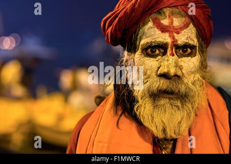 Portrait of an Indian sadhu wearing traditional attire in Varanasi, Uttar Pradesh, India. - Stock Photo
