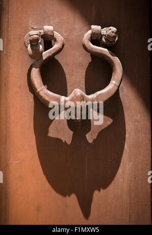 Antique Wrought Iron Door Knocker In A Side Street Of Martina Franca, In  The Itria