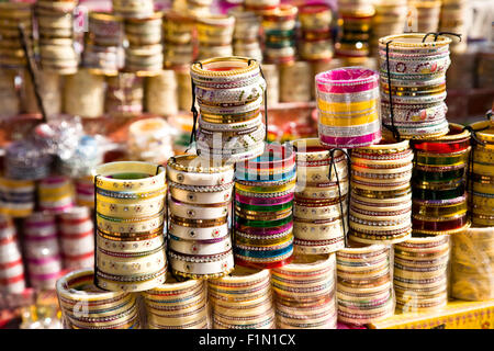 A number of traditional Indian bangles or armbands on a market in Jodhpur, Rajasthan, India - Stock Photo