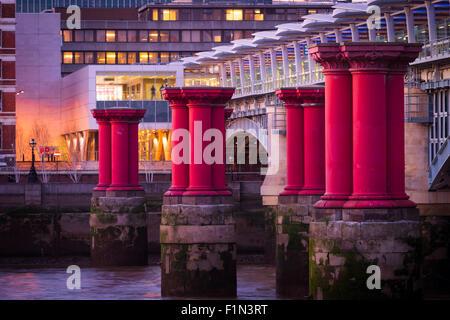 A close up of the purple pillars running alongside Blackfriars bridge in London - Stock Photo