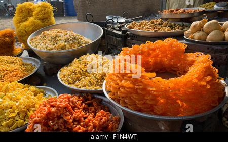 Sweet and savory snacks for sale at a stand in Sillod India on the road from the Ellora Caves to Aurangabad - Stock Photo