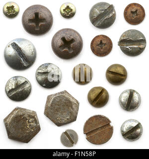 A pile of nuts,bolts, screws and other fasteners on a white background - Stock Photo