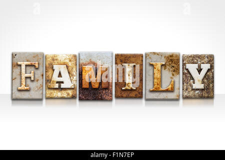 The word 'FAMILY' written in rusty metal letterpress type isolated on a white background. - Stock Photo