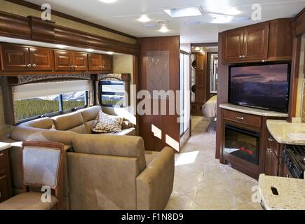 The inside of a luxury motor coach tour bus stock photo for Motor coaches with 2 bedrooms