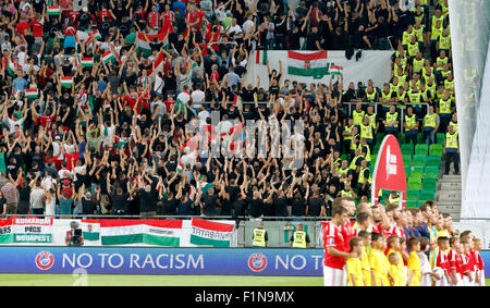 BUDAPEST, HUNGARY - SEPTEMBER 4, 2015: Hungarian fans show their back during the Romanian anthem during Hungary - Stock Photo