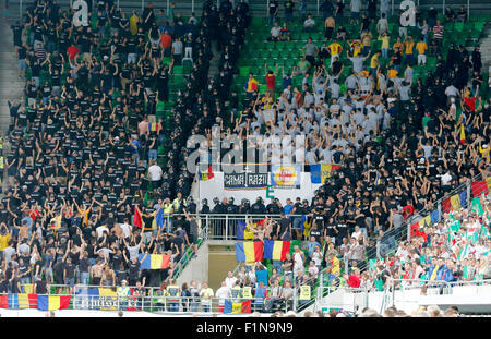 BUDAPEST, HUNGARY - SEPTEMBER 4, 2015: Romanian fans show their back during the Hungarian anthem during Hungary - Stock Photo