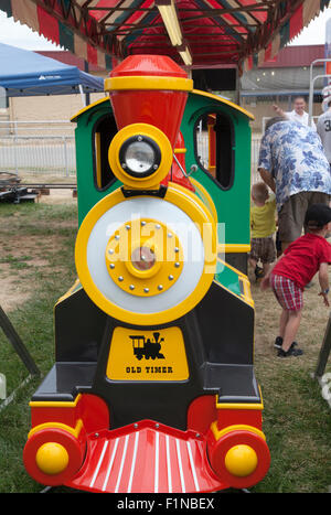 Children's train ride at the Fair, US, 2015. - Stock Photo