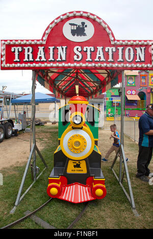 Children's train ride and sign at the Fair, US, 2015. - Stock Photo