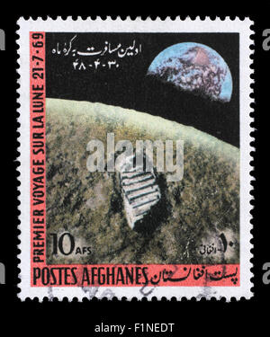 Stamp printed in the Afghanistan shows First Moon Landing - 1969, circa 1970. - Stock Photo