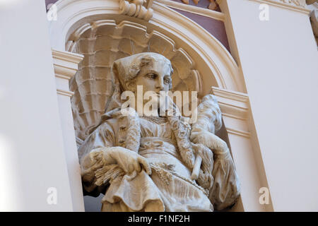 Statue on facade of the old city building in Zagreb, Croatia on February 15, 2015 - Stock Photo