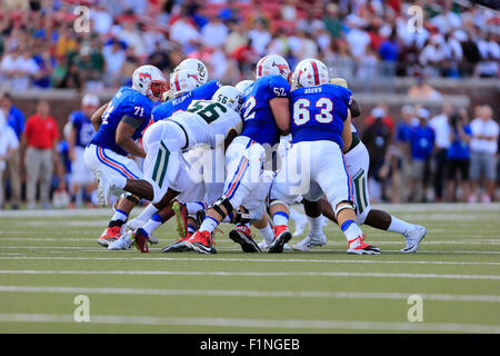Dallas, TX, USA. 4th Sep, 2015. Gang tackle during the NCAA football game between the Baylor Bears and the SMU Mustangs - Stock Photo
