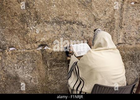 Prayer prays at Western Wall in Jerusalem, Israel. - Stock Photo