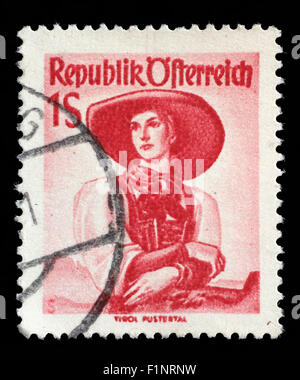 Stamp printed in Austria, shows a woman in national dress, Tirol, Pustertal, circa 1949 - Stock Photo