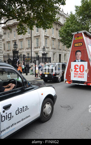 Families and supporters of London's Black taxi drivers protested outside Downing Street against apparent support - Stock Photo