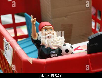 Toy soccer player with a white beard, flea market, Germany. - Stock Photo
