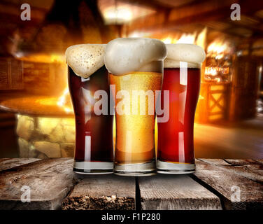 Three glasses of beer on a table in bar - Stock Photo