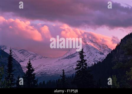 Sunset Light On Clouds Above Jackson Glacier, Glacier National Park, Montana, USA - Stock Photo