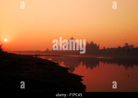 A sunrise view of Taj Mahal in Agra, India. - Stock Photo