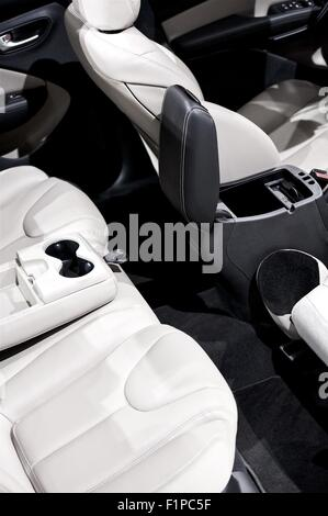 Car Interior - Seats. Small Passenger Car Interior. White Leather Seats. Transportation Photo Collection. - Stock Photo
