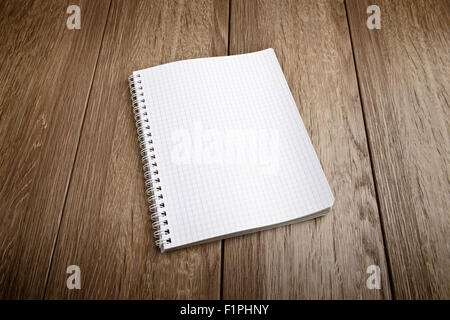 white notebook paper on  wood table - Stock Photo