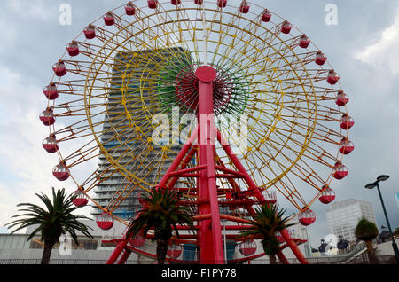 Ferris wheel and tower at Kobe Harborland on July 9, 2015 in Kobe, Japan - Stock Photo