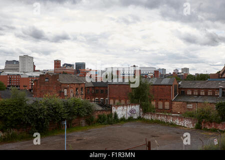 view of Birmingham city centre across various brown field and derelict old buildings UK - Stock Photo