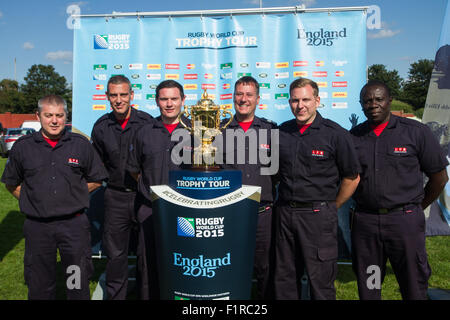 London, UK. 06th September 2015. London Fire Brigade Newham firefighters photographed with the Webb Ellis Cup on - Stock Photo