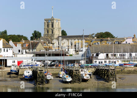 View of the Church at Shoreham on Sea West Sussex looking across the river Adur. Boat yard and boats in the foreground. - Stock Photo