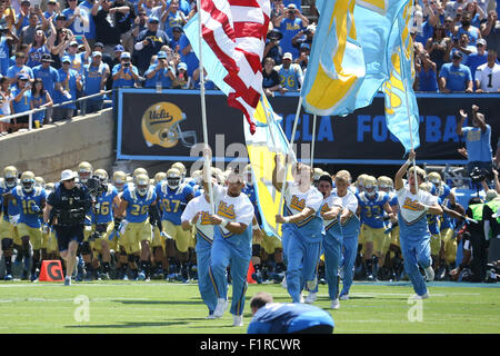 Pasadena, CA. 5th Sep, 2015. UCLA takes the field before the game between the Virginia Cavaliers and the UCLA Bruins, - Stock Photo