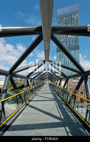 The refurbished Exhibition Footbridge crossing Whitworth Street West near Deansgate in Manchester. - Stock Photo