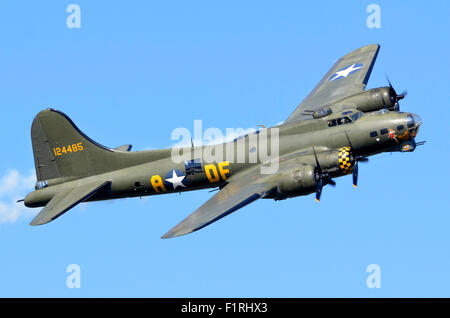 Boeing B-17G Flying Fortress 'Sally B' making a low flypast at Cosby Victory Show, Leicestershire, UK, 2015. Credit: - Stock Photo