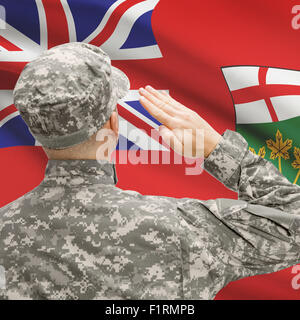 Soldier saluting to Canadial province flag conceptual series - Ontario - Stock Photo