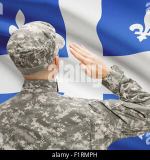 Soldier saluting to Canadial province flag conceptual series - Quebec - Stock Photo
