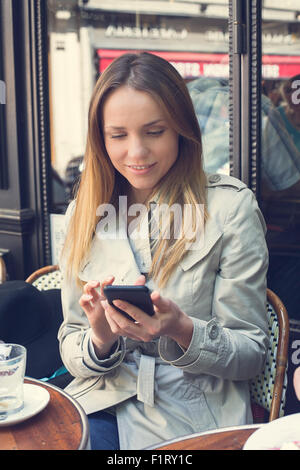 Paris, Woman Text messaging - Stock Photo