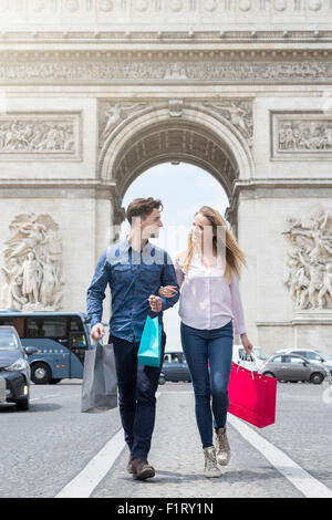 Couple shopping on Avenue des Champs Elysees - Stock Photo