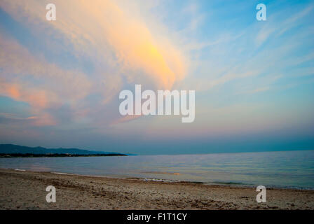 Colorful landscape at the beach with clouds and sunset colors in summertime