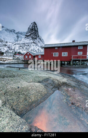 Typical red houses of fishermen called Rorbu, Reine. Lofoten Islands, Northern Norway, Scandinavia, Arctic, Europe - Stock Photo