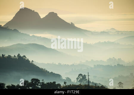 Sunrise and fog over the mountains surrounding Blantyre, Malawi, Africa - Stock Photo