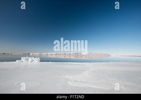 Hunting blind made from ice blocks at the Floe edge, the junction of sea ice and the ocean, Greenland, Denmark - Stock Photo