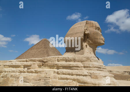 Sphinx in foreground, and the Great Pyramid of Cheops, The Giza Pyramids, UNESCO World Heritage Site, Giza, Egypt, - Stock Photo